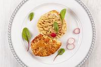 Vegetable spread on bread with radish.