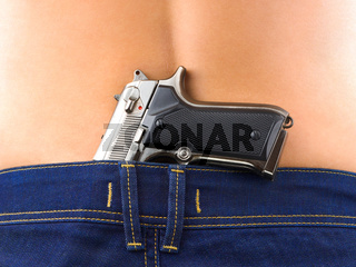 Woman in jeans and gun