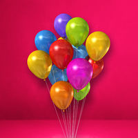 Colorful balloons bunch on a pink wall background