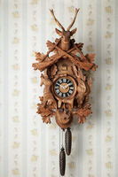 Cuckoo clock in front of wallpaper wall