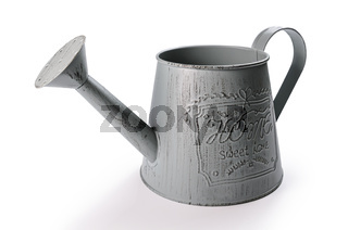 decorative garden watering can on white background with soft shadow
