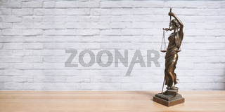 Lady Justice or Justitia statue on desk - legal law jurisdiction concept