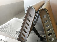 Uncomfortable metal bench / chair at airport waiting hall.