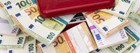 bundles of many Euro banknotes