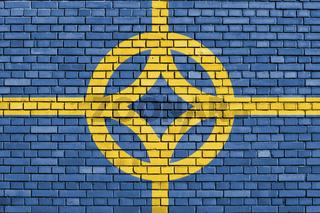 flag of West Plains, Missouri painted on brick wall