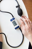Measurement of blood pressure. The woman measures blood pressure. Self-diagnosis at home. View from above. Health and care concept.