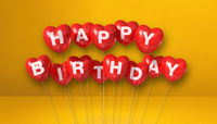 Red happy birthday heart shape air balloons on a yellow background scene. Horizontal Banner