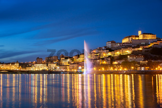 Coimbra city view at night with Mondego river and beautiful historic buildings, in Portugal