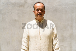 Portrait of Indian man outdoors during sunny day