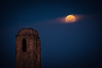 the ruins of the church tower and the moonrise in full moon