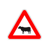 Cow icon on the triangle red and white road sign on white