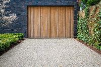 wide garage door and concrete driveway in front