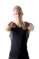 Fit male model pointing fingers to camera on white background