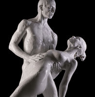 Naked couple in white paint in studio
