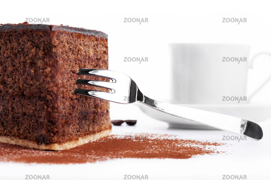 chocolate cake with a fork and a cup of coffee in
