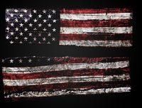 Distressed American flag cracked in half ob black background