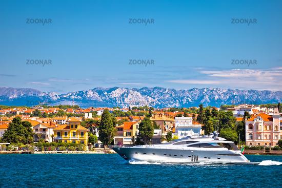 Zadar waterfront and speedboat yacht view, Velebit mountain background