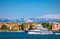 Zadar waterfront and speedboat yacht view, Velebit mountain background