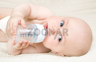 Baby with a water bottle