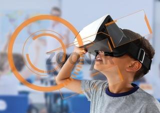 Schoolboy using VR helmet in classroom