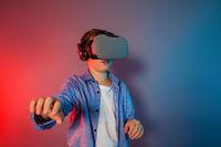 Teenager boy using a gaming gadget for virtual reality