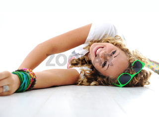 Young teen girl lying on floor