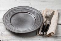 Plate, knife and fork on a wooden table