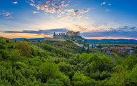 the ruins of Beckov Castle in the light of the setting sun
