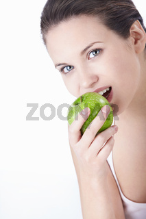 Attractive young girl eating an apple isolated