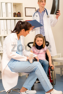 Young girl on wheelchair visit doctor
