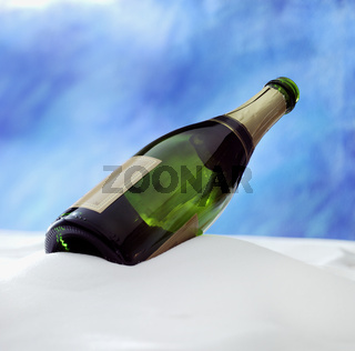 champagne botlle in the snow with