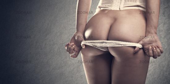 Lingerie. Sexy body, funny nude female portrait.