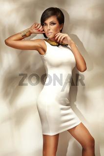 Young woman wearing fashionable white dress