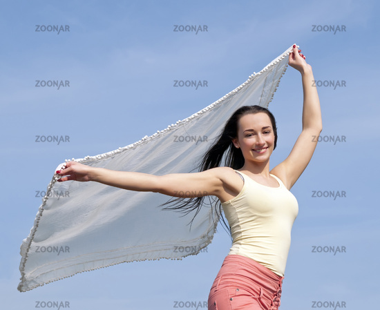 woman holding white cloth in wind