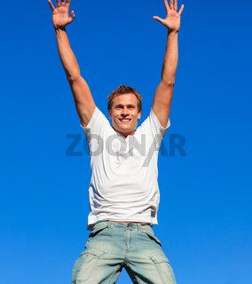 Happy Man jumping in the air outdoor