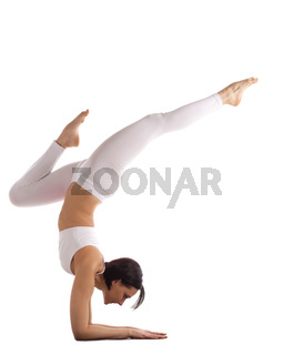 athletic woman in white balance on hands isolated