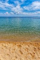 Summer beach background. Sand, sea and sky