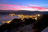 Baska. Aerial sunset burning sky view of town of Baska