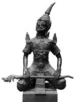 Bronze hanuman statue isolated over white. Hanuman sits in lotus pose with mace