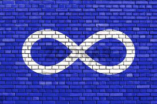 flag of Metis people painted on brick wall