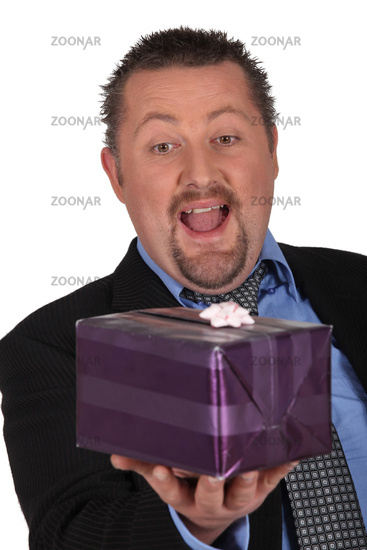 Businessman openmouthed at a gift