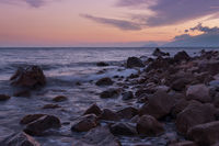 Rocky shore during a beautiful sunset over the sea.