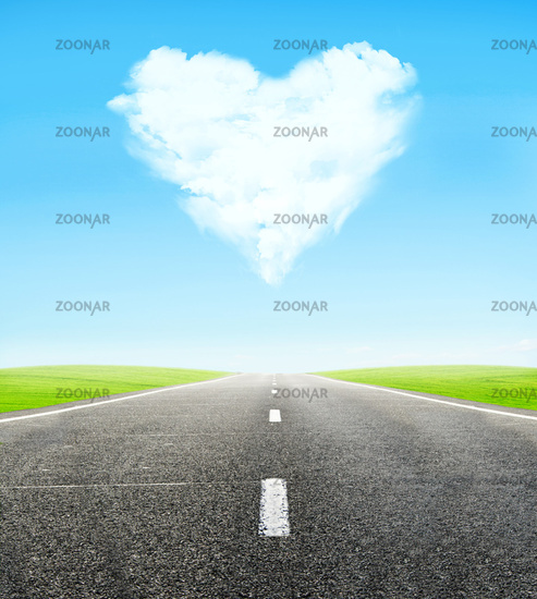 road and cloudy heart in sky