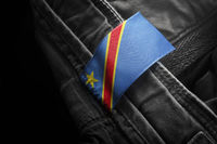 Tag on dark clothing in the form of the flag of the Democratic Republic of the Congo