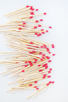 Long matches with a red head on a white background. Kitchen, ignition, gas, flammable.