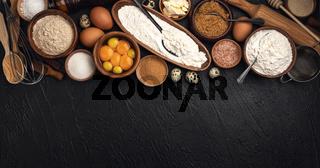Baking ingredients on black background, top view