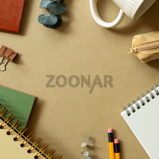 Various office supplies on brown background. workspace. flat lay, top view, copy space