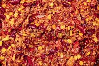Chili con carne texture, overhead view, traditional Mexican dish