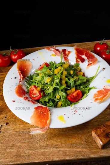 Rocket salad with dried Spanish ham