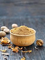 Nutmeg ground in bowl on dark board
